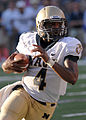 US Navy 100906-N-3857R-017 U.S. Naval Academy quarterback Ricky Dobbs attempts to break into open field during Navy's first varsity football game o.jpg