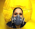 US Navy 101013-N-5361G-080 Logistics Specialist 2nd Class Jessica Gonzales, from San Antonio, performs a fit test on a P100 respirator to ensure a.jpg