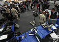 US Navy 110529-N-NW961-192 Visitors watch demonstrations at the Navy Explosive Ordnance Disposal discovery table aboard the USS Midway Museum durin.jpg