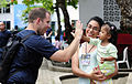 US Navy 110609-N-EP471-242 Hospital Corpsman 2nd Class Kirby Boudreaux plays a game with a young patient during a Continuing Promise 2011 community.jpg