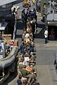 US Navy 110829-N-GH121-072 Sailors and Marines move stores aboard the amphibious dock landing ship USS Whidbey Island (LSD 41) during a vertical re.jpg
