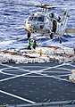 US Navy 111228-N-VO377-029 An MH-60S Sea Hawk helicopter from the Golden Falcons of Helicopter Sea Combat Squadron (HSC) 12 transports ammunition.jpg