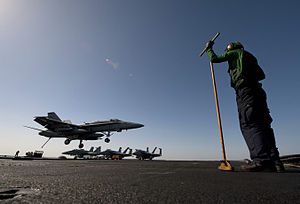 US Navy 120206-N-DR144-755 A Sailor assigned to the air department aboard the Nimitz-class aircraft carrier USS Carl Vinson (CVN 70) waits to guide.jpg