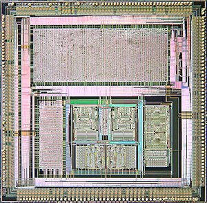 Application-specific integrated circuit - Microscope photograph of custom ASIC (486 chipset) showing gate-based design on top and custom circuitry on bottom