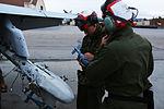 VMFA-122 Ordnance Marines keep Hornets armed in any weather 140903-M-RQ061-005.jpg