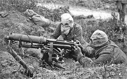 Vickers machine gun crew with gas masks.jpg