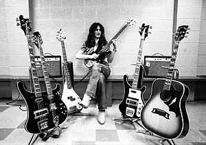 Geddy Lee - Lee on tour with various basses and an acoustic guitar