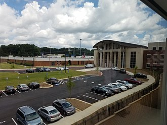 George Walton Comprehensive High School - The front entrance of the New 2017 Walton Building from a second floor classroom, with the old building on left.