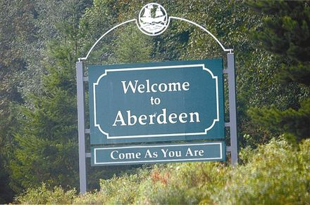 "Sign erected in 2005 in Cobain's hometown of Aberdeen, Washington in tribute to him. It was paid for by the Kurt Cobain Memorial Committee and is a reference to the Nirvana song ""Come as You Are"". Welcome to Aberdeen.jpg"