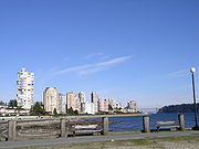 Apartment and condominium towers lined along the seawall.