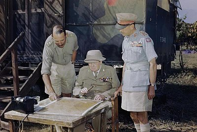 Winston Churchill discussing the battle situation in Italy with the Commander of the Eighth Army, Lieutenant General Sir Oliver Leese (left) and the Supreme Allied Commander Mediterranean, General Sir Harold Alexander, TR2281.jpg