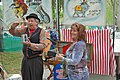 Woman has helped Dardenell - Alberti Flea Circus, MerleFest 2013.jpg