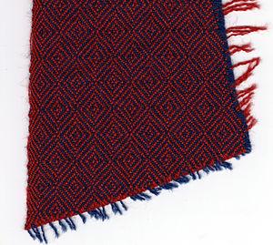 Twill - Diamond twill, with weaving edge (left), blue warp, red weft
