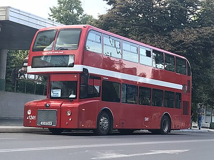 A red Yutong City Master double-decker bus in Skopje.