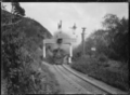 """Ww"" class steam locomotive passing automatic three position electric signals in the Silverstream Gorge. ATLIB 293610.png"