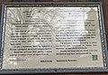 Табличка про історію церкви на дверях дзвіниці.jpg