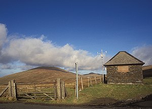 Snaefell Mountain Course - Brandywell TT Race Marshal Shelter and Weather Station on the A18 Mountain Road/B10 Sartfield Road looking north towards Snaefell Mountain and North Barrule