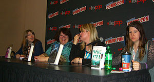 "Maureen Johnson - Johnson, at right, at the ""Justice is Served"" panel discussion at the 2012 New York Comic Con. Sharing the table with her are (l-r): Amber Benson, Rachel Caine and Morgan Rhodes."