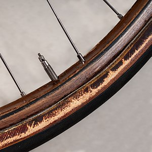 Rim (wheel) - wooden bicycle rim with tubular tyre