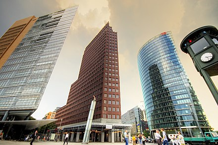 Potsdamer Platz, Kollhoff Tower at the center and headquarters of Deutsche Bahn to the right. 17 20 pm (570903628).jpg