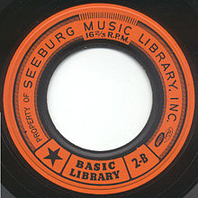 Orange Muzak record label, with large hole
