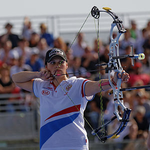 Compound bow - Albina Loginova at women's individual compound 3rd place, 2013 FITA Archery World Cup, Paris, France.