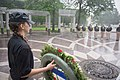2015 Law Enforcement Explorers Conference girl stands behind wreath.jpg