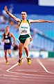 301000 - Athletics track Tim Sullivan waves action - 3b - 2000 Sydney race photo.jpg