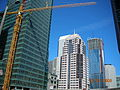 555 Mission Street, tower crane disassembly (both on the left) and the Millennium Tower (301 Mission Street) on the right March 2008.JPG
