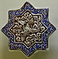 8-pointed star tile, luster technique, glazed. Ilkhanate period, 2nd half of the 13th century CE. From Kashan, Iran. Museum of Islamic Art (Tiled Kiosk), Istanbul.jpg