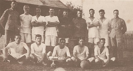 The football team of 95 Company, Royal Garrison Artillery, victors in the 1917 Governor's Cup football match, pose with the cup. The cup was contested annually by teams from the various Royal Navy, British Army Bermuda Garrison, and Royal Air Force units stationed in Bermuda. 95 Coy RGA team and Governor's Cup in Bermuda 1917.jpg