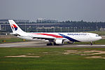 9M-MTG - Malaysia Airlines - Airbus A330-323 - CAN (14803680750).jpg