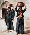 ARAB WOMEN IN JERUSALEM CARRYING CONTAINERS FILLED WITH LABANEH.jpg