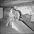 ATS woman repairs motorbike in Leicester 1939-45 H37800.jpg