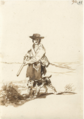 A HUNTER WITH HIS DOG IN A LANDSCAPE.PNG
