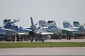 A U.S. Air Force F-16C Fighting Falcon aircraft, foreground, taxis on the ramp before an interception mission with Ukrainian SU-27 aircraft at Mirgorod Air Base, Ukraine, July 19, 2011, during Safe Skies 2011 110719-A-ZZ999-052.jpg