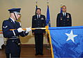 A U.S. Air Force airman with the honor guard unfurls the one star flag during a promotion ceremony for Brig. Gen. Bradley Spacy, chief, senate liaison with the Office of the Secretary of the Air Force, at 120517-F-BD983-010.jpg