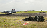A U.S. Marine Corps F-A-18C Hornet aircraft slows down after its tailhook is trapped by the wire on a field arresting system at Clark Airfield, Pampanga province, Philippines, Oct. 2, 2013, during Amphibious 131002-M-SO590-003.jpg