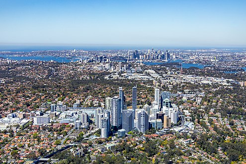 Aerial view of Chatswood, Australia, looking towards Sydney. The boundaries between low density residential, commercial and industrial zones are clearly visible. Aerial View Chatswood to Sydney CBD.jpg
