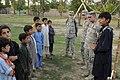 Afghan boy scouts with PRT Nangarhar officers DVIDS305783.jpg