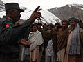 Afghan policeman Zamir Ghul, the district chief of police for Donde Ghori, speaks to Afghan elders during a presence patrol in Bibi Gawara, Donde Ghori district, Baghlan province, Afghanistan, Feb 120211-A-BT925-005.jpg