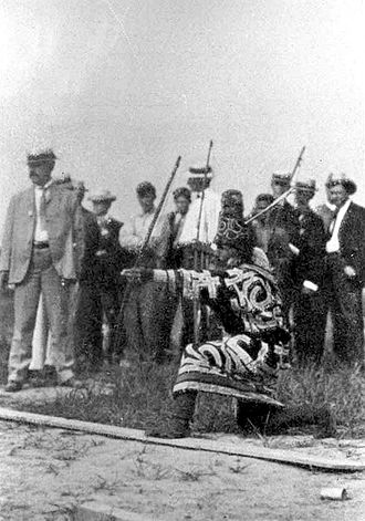 "1904 Summer Olympics - An Ainu man competing in an archery contest during ""Anthropology Days"""