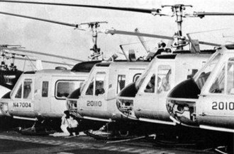 Air America (airline) - Air America Bell 205s being evacuated aboard USS Hancock, in 1975.