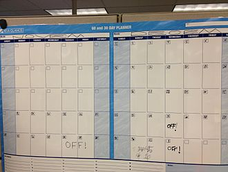 Workweek and weekend - This day planner chart (which can be used for any months) shows the workweek days as white boxes and the weekend days as light blue-coloured boxes.