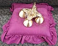 Altar bell on pillow.jpg