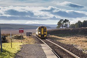 Altnabreac Station Approaching Train to Wick (16351516469).jpg