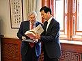 Ambassador Brandstad Exchanges Books with Professor YU Keping, Dean Chair, School of Government, Peking University (40303200035).jpg