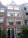 foto van Huis met gevel onder klokvormige top met rollagen