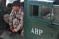 An Afghan Border Police officer laces his boots prior to a mission, in the Nangarhar province, Afghanistan, Feb. 14, 2012 120214-A-LP603-098.jpg