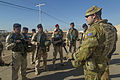 An Australian soldier assigned to Task Group Taji conducts an after action review with Iraqi soldiers assigned to 71st Iraqi Army Brigade at Camp Taji in November 2015.jpg